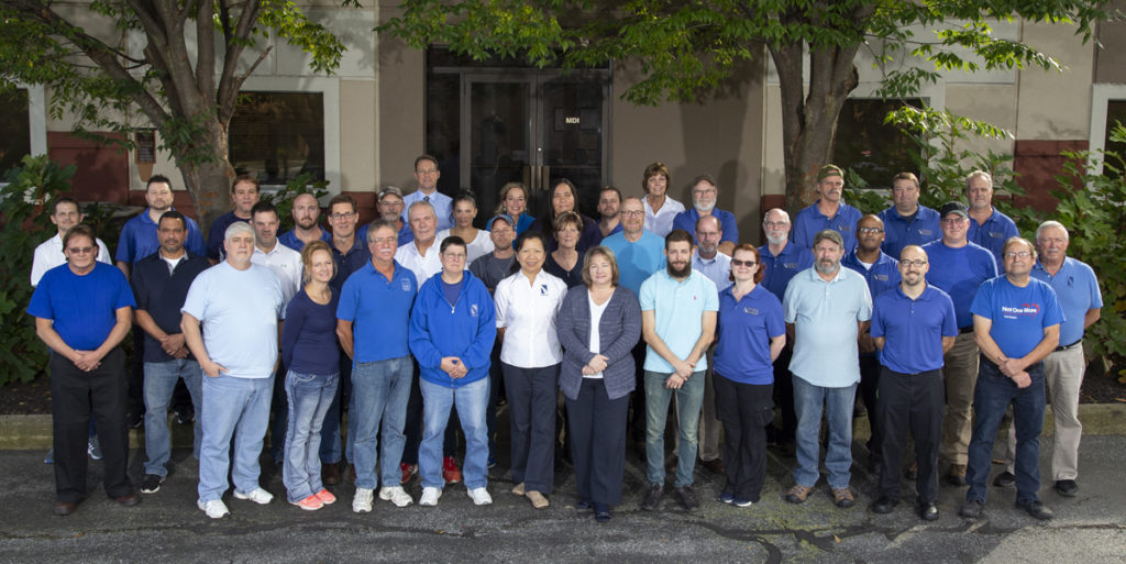 Medical Device & Implants team photo in front of building