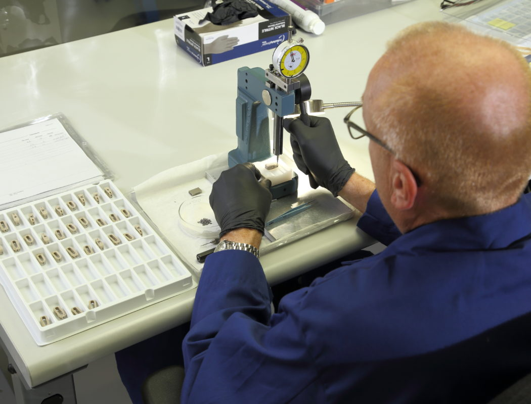 a man working with a medical device or implant